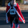 SAM GORESH/Staff photo. Nicholas Poulin, 11, waits for the start of the kids dash at the Law Enforcement Torch Run at Analogic benefitting the Special Olympics. 12/4/16
