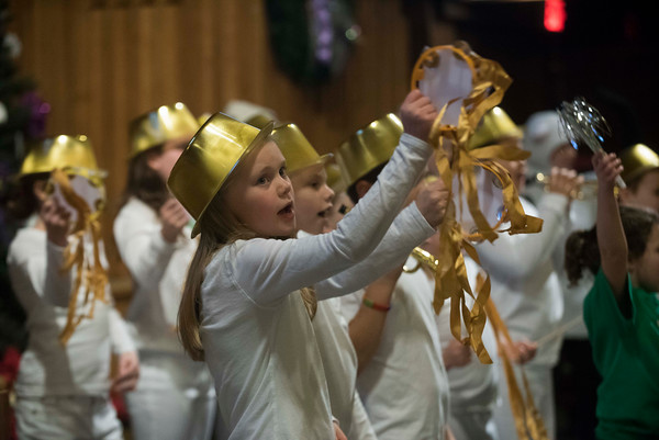 """SAM GORESH/Staff photo. Taylor Landry performs with the Angel Band in """"All About that Baby,"""" at Holy Trinity United Methodist Church in Danvers. """"All About that Baby,"""" tells the story of the Nativity through the perspective of a Shepherd named Nathaniel and his taking sheep. 12/24/16"""