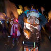 Xavier Cordy, 7, adjusts his hat while walking in the Grand Procession parade as it makes its way down Cabot Street during Beverly's New Year's celebration. 12/30/16
