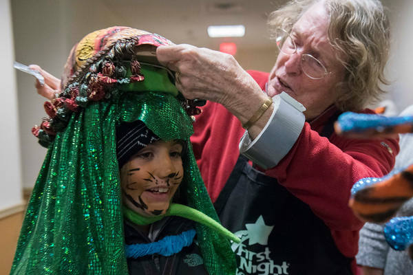 SAM GORESH/Staff photo. Margo Jones (right) adjusts Jane Cosmas's, 7, (left) costume before the Grand Procession parade during Beverly's New Year's celebration on Cabot Street. Over the years Jones has made most of the costumes people wear in the procession. 12/30/16