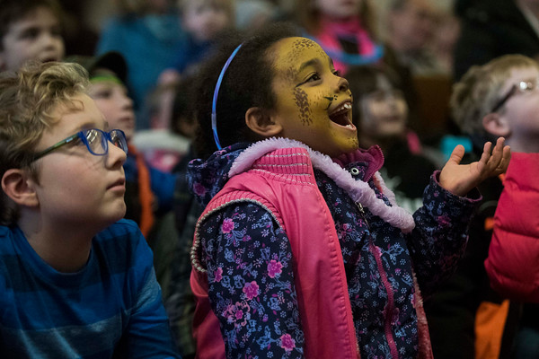 Jada Shakoor, 7, laughs during a magic show at the Fist Baptist Church during Beverly's New Year's celebration on Cabot Street. 12/30/16