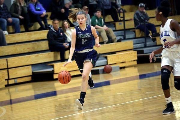 HADLEY GREEN/Staff photo<br /> Pingree's Savannah Gibbs (12) moves the ball at the Pingree v. Dana Hall girls basketball game at the Pingree School.