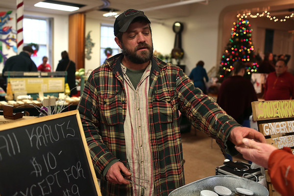 HADLEY GREEN/Staff photo<br /> Dylan L'Abbe-Lindquist of Pigeon Cover Ferments sells sauerkraut at the Cape Ann Farmer's Market at the Unitarian Universalist Church in Gloucester.<br /> <br /> 12/23/17