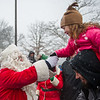 AMANDA SABGA/Staff photo. <br /> <br /> Santa greets Aubrey Vacketta, 5, and her dad Brandon, of Danvers, after he arrives at the annual Santa by the Sea event at Pope's Landing in Danvers.<br /> <br /> 12/9/17