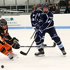 HADLEY GREEN/Staff photo<br /> Peabody's Ryan Huber (3) moves the puck at the Beverly v. Peabody boys hockey game at Endicott College.<br /> 12/20/17