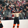 HADLEY GREEN/Staff photo<br /> Beverly fans cheer after the team scores at the Beverly v. Peabody boys hockey game at Endicott College.<br /> 12/20/17