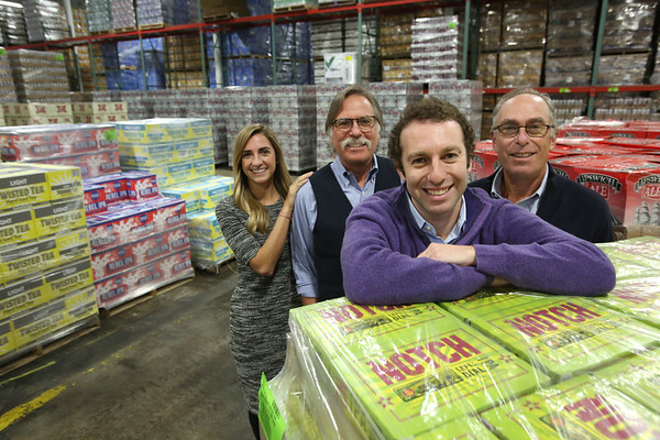 Ken Yuszkus/Staff photo   From left, Jennifer, Jack, Mark, and Richard Tatelman in the Merrimack Valley Distributors warehouse.       12/7/17