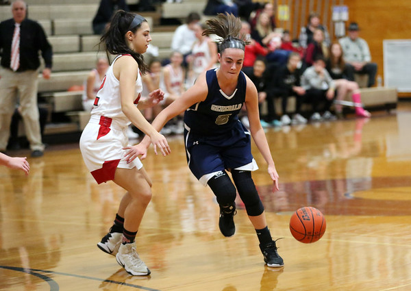 HADLEY GREEN/Staff photo<br /> Hamilton-Wenham's Jacqueline Fibbe (5) dribbles the ball at the Masconomet v. Hamilton-Wenham girls basketball game at Masconomet High School.