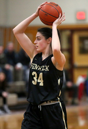 HADLEY GREEN/Staff photo<br /> Bishop Fenwick's Jennie Meagher (34) looks for an open pass at the Masconomet v. Bishop Fenwick girls basketball game at Masconomet High School.<br /> <br /> 12/23/17