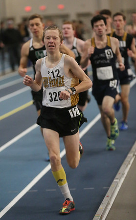 MIKE SPRINGER/Staff photo<br /> Zach Mizioch of Bishop Fenwick competes in the two-mile run during a Tri-County Track & Field League meet Tuesday at the Reggie Lewis Track and Field Center in Roxbury Crossing.<br /> 12/26/2017