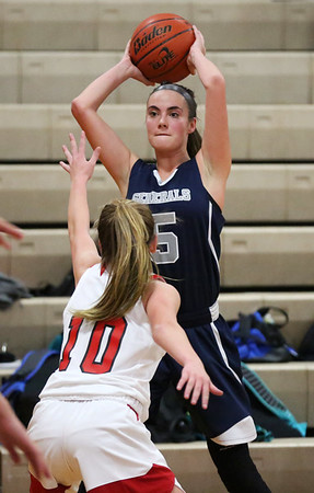 HADLEY GREEN/Staff photo<br /> Hamilton-Wenham's Jacqueline Fibbe (5) looks for a pass at the Masconomet v. Hamilton-Wenham girls basketball game at Masconomet High School.