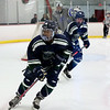 HADLEY GREEN/Staff photo<br /> Pingree's Amogh Prakash (8) skates to the puck at the Pingree v. Berwick Academy boys hockey game at the Pingree School.