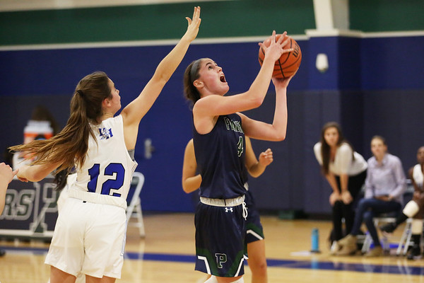 HADLEY GREEN/Staff photo<br /> Pingree's Colby Shea (4) scores while Dana Hall's Catey McCarron (12) plays defense at the Pingree v. Dana Hall girls basketball game at the Pingree School.