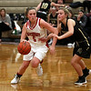 HADLEY GREEN/Staff photo<br /> Masconomet's Paige Amyouny (5) moves the ball while Bishop Fenwick's Sam Tache (20) plays defense at the Masconomet v. Bishop Fenwick girls basketball game at Masconomet High School.<br /> <br /> 12/23/17