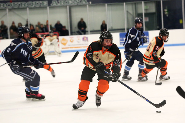 HADLEY GREEN/Staff photo<br /> Beverly's Timothy McCarthy (11) moves the puck towards the net at the Beverly v. Peabody boys hockey game at Endicott College.<br /> 12/20/17