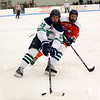 HADLEY GREEN/Staff photo<br /> Endicott's Logan Day (19) moves the puck while Salem State's Trey Olson (4) plays defense at the Endicott v. Salem State boys hockey game at Endicott College.