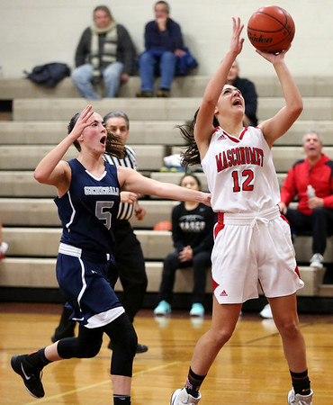 HADLEY GREEN/Staff photo<br /> Masconomet's Sara Fogarty (12) shoots at the Masconomet v. Hamilton-Wenham girls basketball game at Masconomet High School.