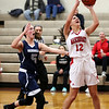 HADLEY GREEN/Staff photo<br /> Masconomet's Sara Fogarty (12) shoots at the Masconomet v. Hamilton-Wenham girls basketball game at Masconomet High School.