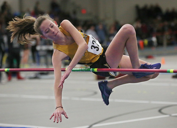 MIKE SPRINGER/Staff photo<br /> Molly O'Hare of Bishop Fenwick competes in the high jump during a Tri-County Track & Field League meet Tuesday at the Reggie Lewis Track and Field Center in Roxbury Crossing.<br /> 12/26/2017