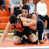 HADLEY GREEN/Staff photo<br /> Peabody's Dante Olowu wrestles against Beverly's Raf Dilone at the Beverly v. Peabody wrestling match at Beverly High School.<br /> 12/20/17