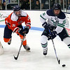 HADLEY GREEN/Staff photo<br /> Endicott's Josh Bowes (15) controls the puck while Salem State's Eric Rogorzenski (14) plays defense at the Endicott v. Salem State boys hockey game at Endicott College.