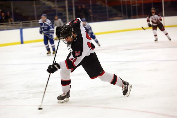 HADLEY GREEN/Staff photo<br /> Marblehead's Gavin Dowley (18) shoots at the Marblehead v. Danvers boys hockey game at the Rockett Arena. <br /> <br /> 12/23/17