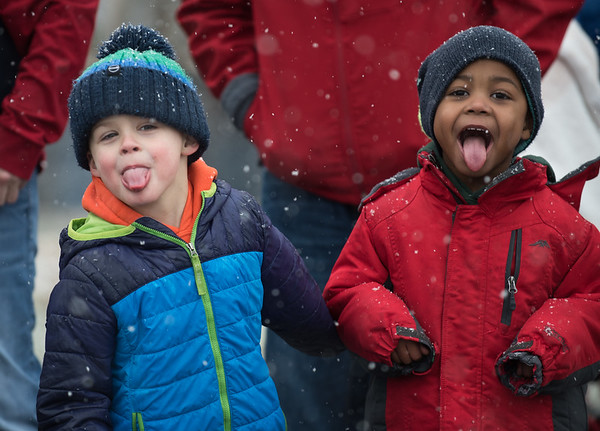 AMANDA SABGA/Staff photo. <br /> <br /> Carter Croucher, 4, of Danvers, and Jerry Fraizer, 4, of Beverly, stick their tongues out to catch snowflakes at the annual Santa by the Sea event at Pope's Landing in Danvers.<br /> <br /> 12/9/17