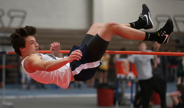 MIKE SPRINGER/Staff photo<br /> Jake Eaton of St. John's Prep competes in the high jump during a Tri-County Track & Field League meet Tuesday at the Reggie Lewis Track and Field Center in Roxbury Crossing.<br /> 12/26/2017