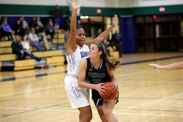 HADLEY GREEN/Staff photo<br /> Peabody's Cameron Dowd (20) looks to make a basket while Dana Hall's Stephanie Daley (24) plays defense at the Pingree v. Dana Hall girls basketball game at the Pingree School.