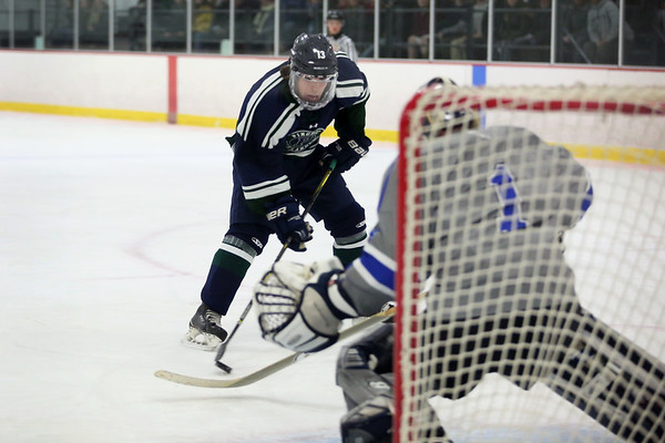 HADLEY GREEN/Staff photo<br /> Pingree's Christian DiMeglio (13) shoots and scores at the Pingree v. Berwick Academy boys hockey game at the Pingree School.