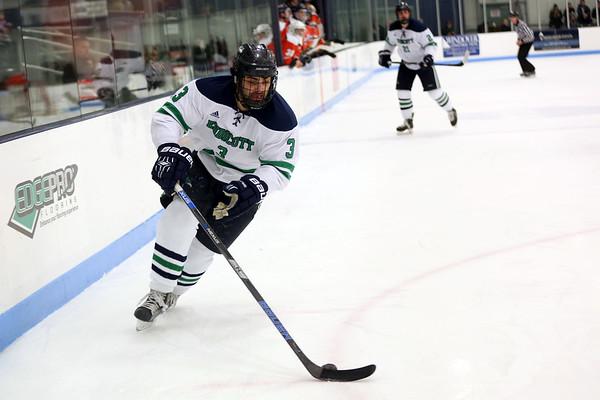 HADLEY GREEN/Staff photo<br /> Endicott's Ryan Dougherty (3) skates towards the net at the Endicott v. Salem State boys hockey game at Endicott College.