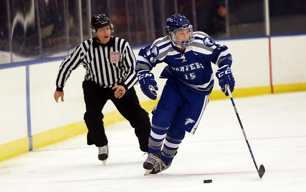 HADLEY GREEN/Staff photo<br /> Danvers' Calvin Mansfield (15) moves the puck at the Marblehead v. Danvers boys hockey game at the Rockett Arena. <br /> <br /> 12/23/17