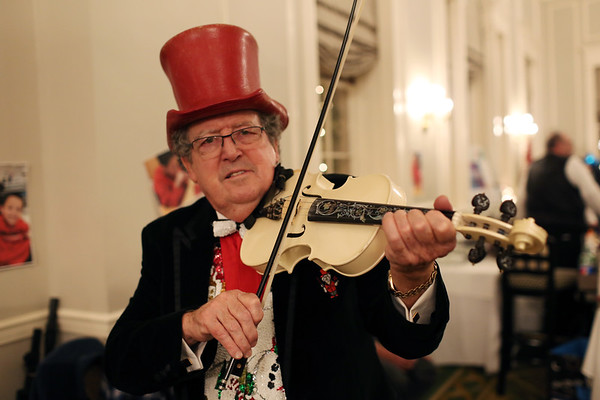 HADLEY GREEN/Staff photo<br /> William Tracy performs at the 24th annual holiday party for Salem Children's Charity at the Hawthorne Hotel.