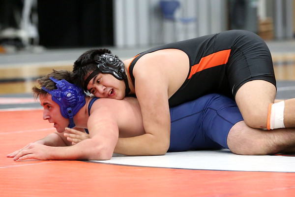 HADLEY GREEN/Staff photo<br /> Peabody's Phil Makoci and Beverly's Edan Piedad wrestle at the Beverly v. Peabody wrestling match at Beverly High School.<br /> 12/20/17