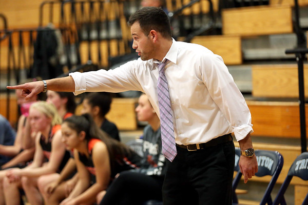 HADLEY GREEN/Staff photo<br /> Ipswich girls basketball coach Chris Tolios motions to players during the Hamilton-Wenham v. Ipswich basketball game at Triton High School.<br /> <br /> 12/27/17