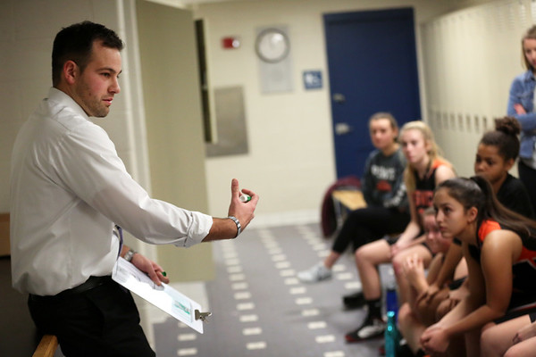 HADLEY GREEN/Staff photo<br /> Ipswich girls basketball coach Chris Tolios talks to players during halftime at the Hamilton-Wenham v. Ipswich game at Triton High School.<br /> <br /> 12/27/17