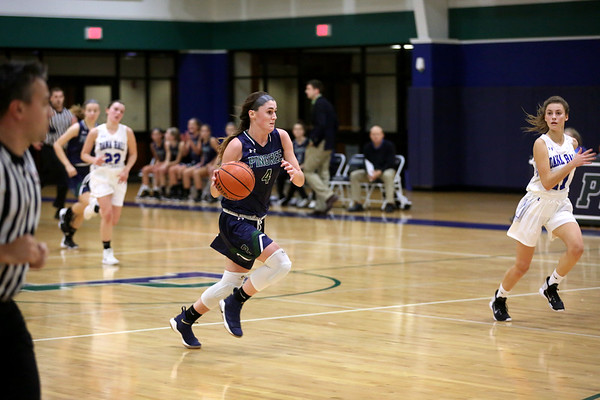 HADLEY GREEN/Staff photo<br /> Pingree's Colby Shea (4) dribbles the ball towards the net at the Pingree v. Dana Hall girls basketball game at the Pingree School.