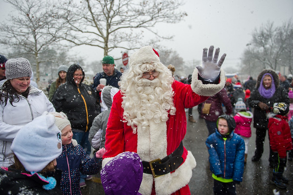 AMANDA SABGA/Staff photo. <br /> <br /> Eager guests greet Santa upon his arrival at the annual Santa by the Sea event at Pope's Landing in Danvers.<br /> <br /> 12/9/17