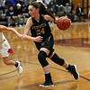 HADLEY GREEN/Staff photo<br /> Bishop Fenwick's Liz Gonzalez (24) dribbles towards the basket while Masconomet's Mak Graves (3) defends her at the Masconomet v. Bishop Fenwick girls basketball game at Masconomet High School.<br /> <br /> 12/23/17