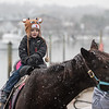 AMANDA SABGA/Staff photo. <br /> <br /> Anthony Laurie, 4, of Danvers, takes a pony ride at the annual Santa by the Sea event at Pope's Landing in Danvers.<br /> <br /> 12/9/17