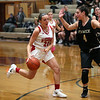 HADLEY GREEN/Staff photo<br /> Masconomet's Cianna Martignetti (23) dribbles towards the basket while Bishop Fenwick's Olivia DiPetro (4) plays defense at the Masconomet v. Bishop Fenwick girls basketball game at Masconomet High School.<br /> <br /> 12/23/17