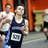 HADLEY GREEN/Staff photo<br /> Peabody's Jared Ridley rounds a corner at the track meet at Beverly High School.