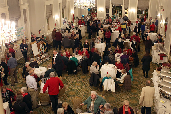 HADLEY GREEN/Staff photo<br /> Crowds mingle at the 24th annual holiday party for Salem Children's Charity at the Hawthorne Hotel.