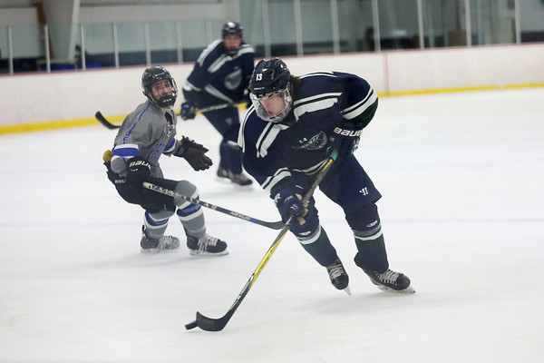 HADLEY GREEN/Staff photo<br /> Pingree's Christian DiMeglio (13) moves towards the net at the Pingree v. Berwick Academy boys hockey game at the Pingree School.