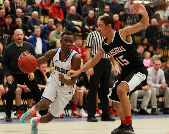 Danvers sophomore guard Rashad Francois (1) drives past Marblehead junior Cian Saunders (15) and goes strong to the hoop during the first half of play on Wednesday evening. DAVID LE/Staff Photo 2/26/14