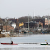 Beverly: A couple kayakers enjoy a warm Saturday morning while paddling through a patch of ice on the Danvers River. DAVID LE/Staff Photo