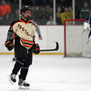 Beverly senior captain Connor Irving (22) screams in celebration after he buried his shootout opportunity against Danvers junior goalie Alex Taylor to put the Panthers up 2-1 in the shootout. DAVID LE/Staff Photo 2/28/14