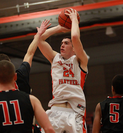 Beverly senior forward Nick Cross takes a jump shot against North Andover on Tuesday evening. DAVID LE/Staff photo 2/25/14