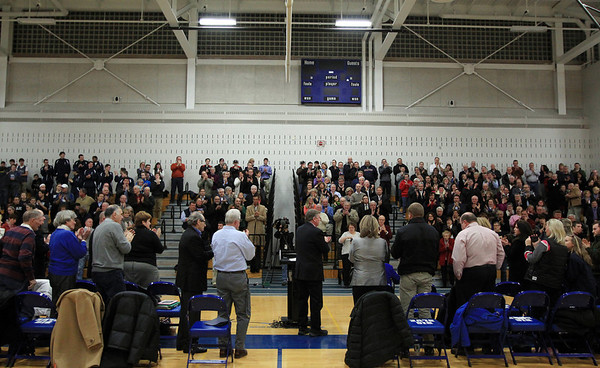"Hundreds of people gathered for the dedication of the Richard ""Dick"" Lynch Gymnasium at Swampscott High School stand and give former Swampscott coach and athletic director Dick Lynch a standing ovation on Tuesday evening. DAVID LE/Staff photo"