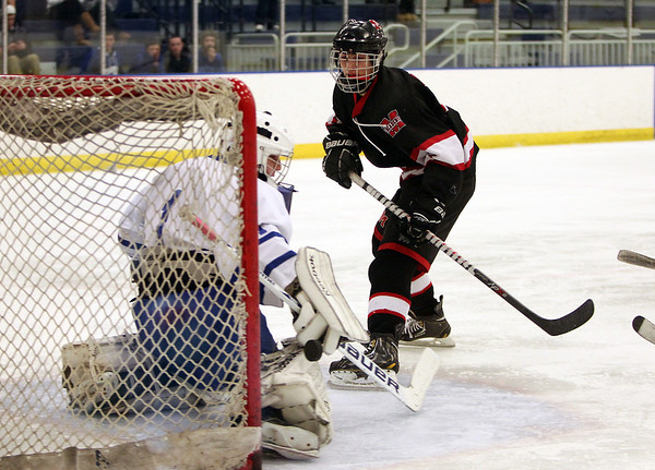 Marblehead sophomore center man Matt Koopman (7) beats Danvers goalie Alex Taylor (1) for one of his three goals on Wednesday evening. DAVID LE/Staff Photo 2/12/14